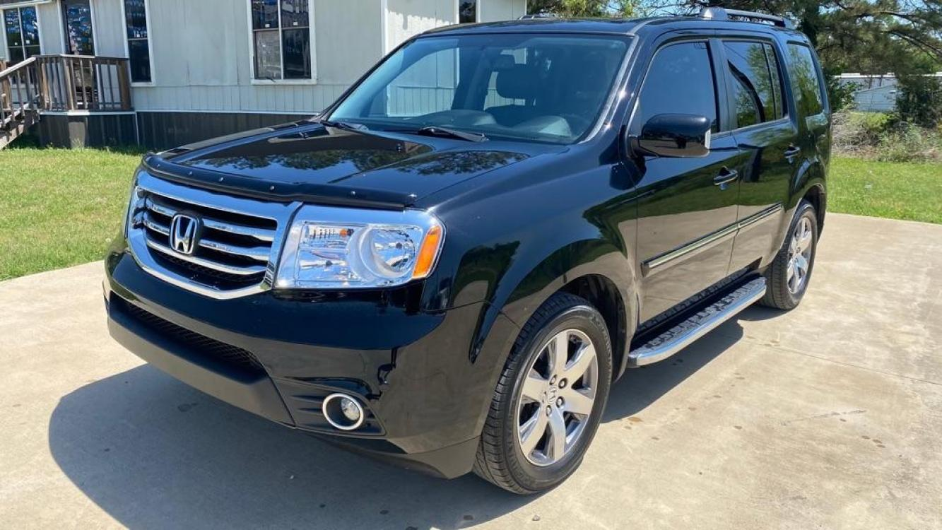 2015 Black HONDA PILOT TOURING (5FNYF4H90FB) with an 3.5L engine, Automatic transmission, located at 3553 US Hwy 190 W., Livingston, TX, 77351, (936) 967-8141, 30.812162, -95.077309 - Photo #0