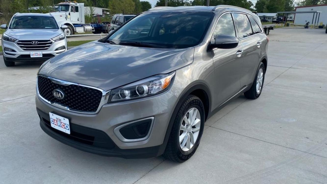 2017 Gray KIA SORENTO LX (5XYPG4A52HG) with an 3.3L engine, Automatic transmission, located at 3553 US Hwy 190 W., Livingston, TX, 77351, (936) 967-8141, 30.812162, -95.077309 - Photo #0