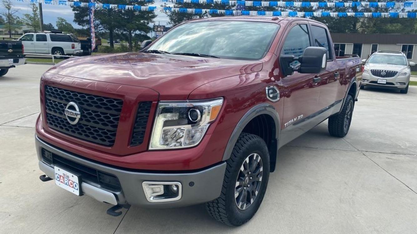 2017 Red NISSAN TITAN XD SL (1N6BA1F46HN) with an 5.0L engine, Automatic transmission, located at 3553 US Hwy 190 W., Livingston, TX, 77351, (936) 967-8141, 30.812162, -95.077309 - Photo #0