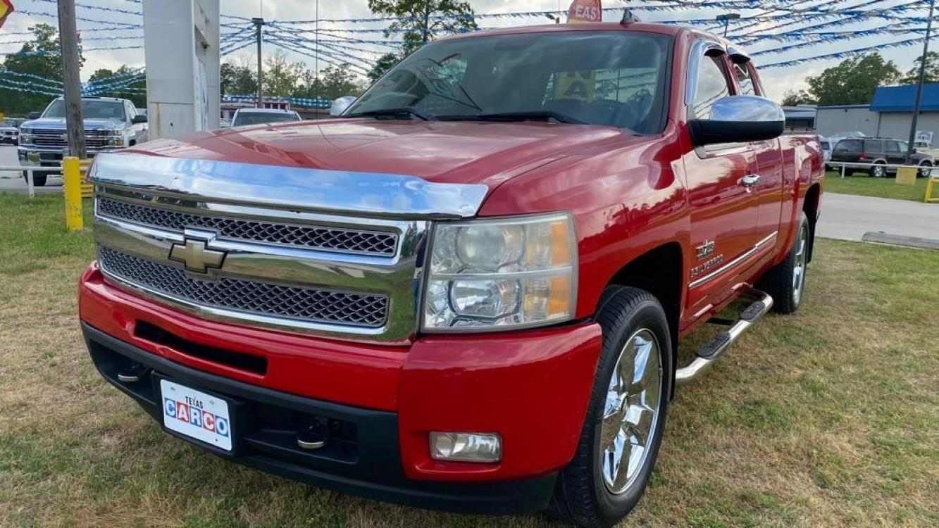 2009 Red CHEVROLET SILVERADO 1500 LTZ (1GCEC39059Z) with an 5.3L engine, Automatic transmission, located at 3553 US Hwy 190 W., Livingston, TX, 77351, (936) 967-8141, 30.812162, -95.077309 - Photo #0