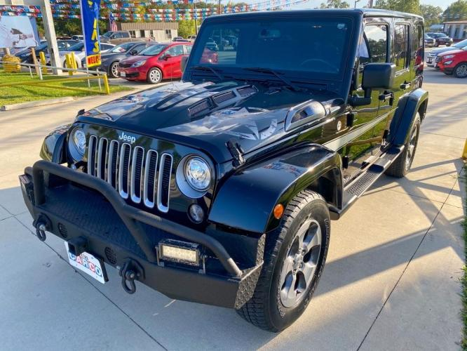 2017 BLACK JEEP WRANGLER UNLIMI SAHARA (1C4BJWEG0HL) with an 3.6L engine, Automatic transmission, located at 3553 US Hwy 190 W., Livingston, TX, 77351, (936) 967-8141, 30.812162, -95.077309 - Photo #0